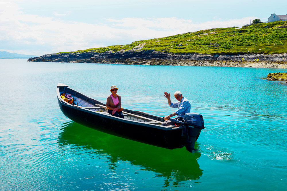 Co Mayo, Ireland, Inishturk Island. Mike O'Toole and his wife, Pauline headding out to Clare Island for the day in the Currach