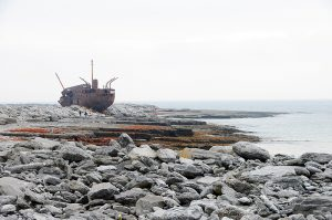 """Shipwreck """"Plassy"""" went aground on Inis Oirr in March 6th 1960. She was carrying general cargo between Limerickand Galway. Inis Oirr (Inisheer), Aran Islands, County Clare, Ireland. © John Ironside"""