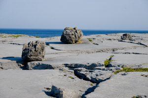 Limestone pavements and Erratic, Burren Landscapes, The Burren, County Clare, Ireland. © John Ironside