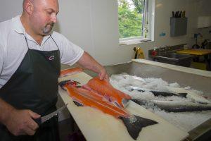 Filleting Wild Irish Salmon at Ballyhack Smokehouse, Arthurstown, Co Wexford, Ireland